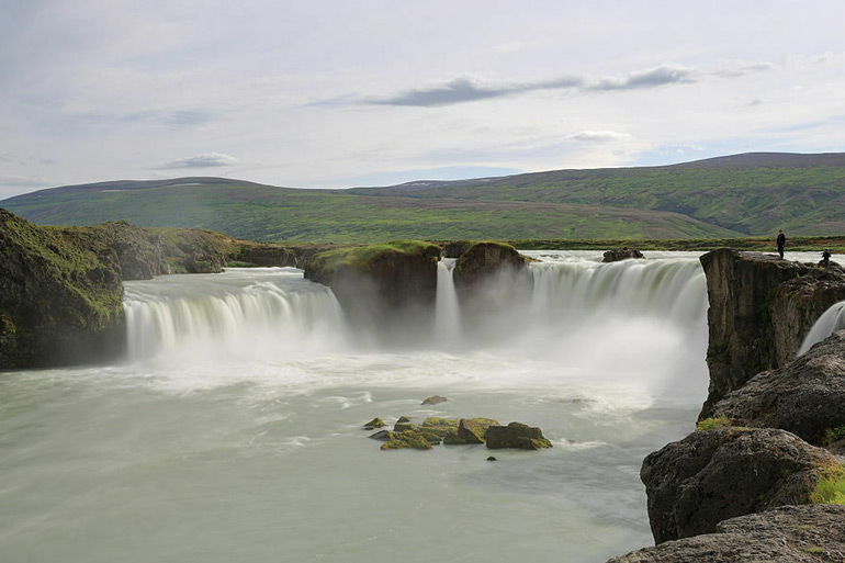 elegant arc of a waterfall marks a religious turning point